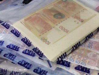 Police arrest three men and seize HK$1.37 million in fake cash during raid on Kowloon flat