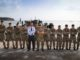 Mark Lancaster poses with the crew of RFA Mounts Bay after watching a Humanitarian Relief and Disaster Relief Exercise on the small volcanic island of Montserrat.