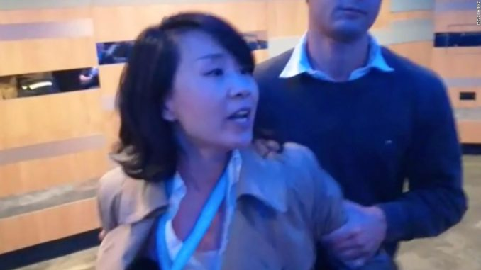 A Chinese journalist was captured on video yelling at a side session of the annual conference of the UK's Conservative Party.