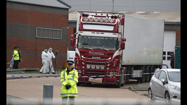 FILE - In this Oct. 23, 2019, file photo, police forensic officers attend the scene after a truck was found to contain a large number of dead bodies, in Thurrock, South England. The discovery in England of the bodies of 39 people believed to be from China lays bare some crucial but sometimes overlooked facts about China's development as a rising global power that has elevated hundreds of millions of its citizens to the middle classes. (AP Photo/Alastair Grant, File)
