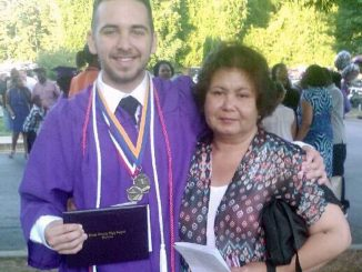 Alma Bowman with her son at his graduation from Jones County High School, at a ceremony held at Georgia College and State University Centennial Center in Milledgeville, Ga., in 2015. BOWMAN FAMILY