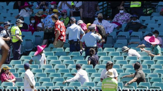 Police escort spectators from the stands during play on Day Four of the third Test match between India and Australia at the Sydney Cricket Ground on Sunday. -- AP